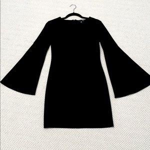 Little black dress or tunic. Bell sleeves.